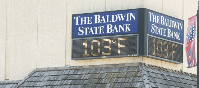 The temperature downtown soared above 100 shortly after noon Monday. Eastern Kansas will get a respite from extreme heat today before triple-digit temperatures return Wednesday and Thursday. Temperatures are predicted to ease somewhat for the weekend, although mid to higher 90s are expected for Friday and Sunday.
