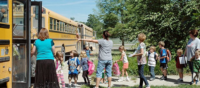 The Baldwin school district will continue to own and operate its bus fleet after the board Monday passed on a proposal from a private company to provide contractual services.