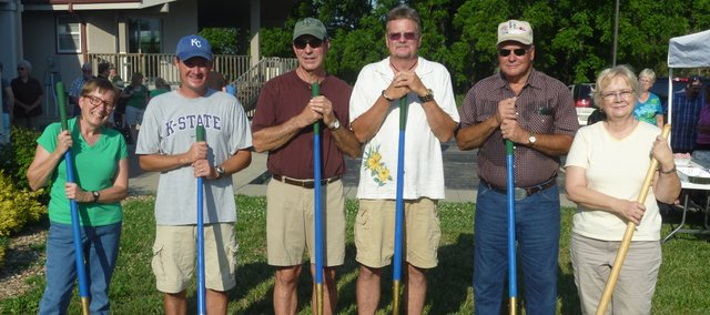 Members of the Basehor United Methodist Church building committee, shovels in hand, prepare to break ground on the church's new building Sunday. From left to right are Pastor Claudia Bakely, Jared Bohndorf, Roger Prelesnik, Ralph Anderton, Elvin Lynn and Linda Haynes.