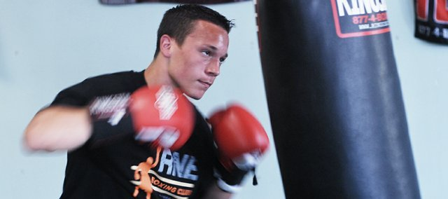 Tyler Holland, 14, won all five of his fights this year, training out of RNE Boxing in Shawnee. Holland, who will be a freshman at SM Northwest this year, won a Junior Olympics regional championship in May. Next year, hell be eligible for nationals.