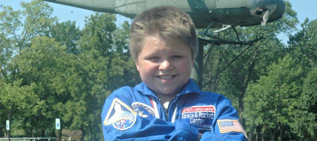 Jackson Willis dons a space suit he received at Space Academy earlier this month in Huntsville, Ala. The Tonganoxie youth, who attended Genesis Christian Academy, will be a seventh-grader at Tonganoxie Middle School in the fall.