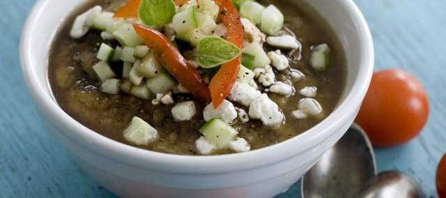 Gazpacho soup prepared with grilled vegetables and topped with feta cheese is the perfect healthy summer food.
