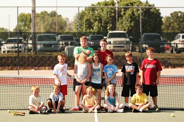 Aaron Lewis, back row right, and fellow Bonner Springs High School tennis teammate Joseph Arnett, left, pose with the young students of their summer tennis camp. Lewis organized the camp as part of his senior project.