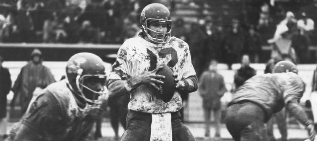 Bonner Springs alum David Jaynes, shown here against Missouri in a file photo from his career at quarterback at Kansas University, will be among nine Kansas Sports Hall of Fame inductees in October.