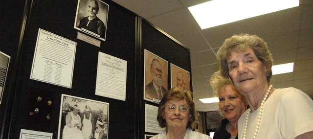 The Basehor Historical Museum's new exhibit on the agricultural history of southern Leavenworth County is the fruit of research conducted by (from left) Earlene Ebert, Carla Crawford and Anna Jean Breuer, with the help of records donated by the Leavenworth County Kansas State University Extension office.