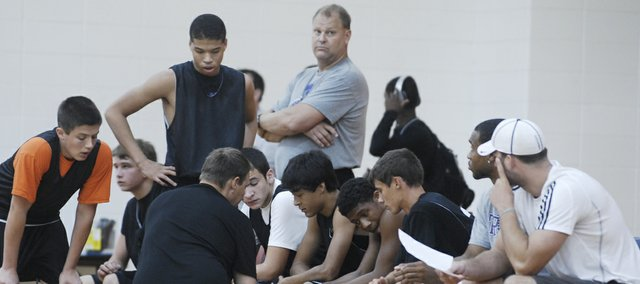 New BSHS boys basketball coach Dan Streit, background in gray, got a look at some of his program's younger players when a Braves team heavy on freshmen and sophomores competed in the MAYB Tournament at Bonner Springs over the weekend.