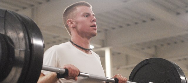 Senior Tanner Garver works out one morning in the Basehor-Linwood Health and Wellness Center as part of the school's seven-week strength and conditioning program. Garver has been participating in the program since seventh grade.