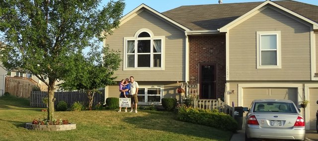 Gary and Debora Matson, with their daughter Alexis, in their yard.
