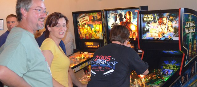 Members of the Kansas City Area Pinball Association participate in a July 21 tournament on the six machines recently installed at Pizza West, 5436 Roberts St.