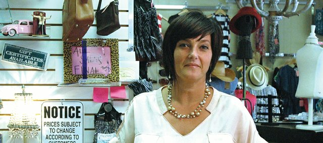 Tamara Hudson opened Encore Unique Boutique in Shawnee in 2003. Area business owners weigh in on what it takes to open a business and keep it open.