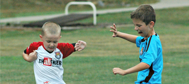 Aiden Van Middlesworth, left, and Michael Irwin battle for a ball Thursday at the Challenger British Soccer Camp at Chieftain Park.