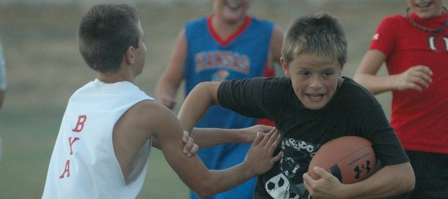 Korbin Riedel was one of 114 kids on hand for last week's youth football camp at Tonganoxie High.