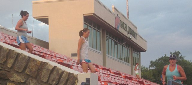 Bulldog Days participants run the Liston Stadium steps during a recent evening of the exercise program.