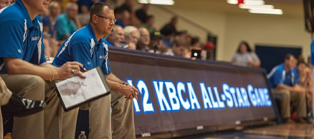 Basehor-Linwood boys basketball coach Mike McBride coached the Kansas Basketball Coaches Association White team in the association's all-star game on Thursday, Aug. 2 at Washburn University's Lee Arena. During the game, McBride was able to coach Ryan Murphy for a final time before Murphy and his twin brother, Colin, departed for Emporia State University.