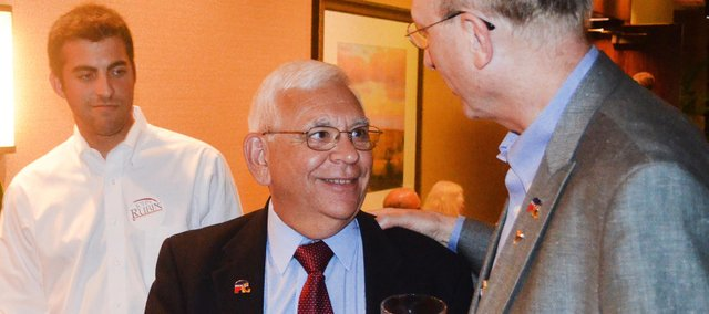 State Rep. John Rubin, R-Shawnee, is congratulated during an election watch party Tuesday night at the Doubletree Hotel in Overland Park was his campaign manager Will Thomas looks on.