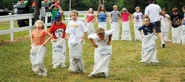 Children compete in a sack race at recent Vinland Fair. The fair in the rural community north of Baldwin City starts Thursday and continues through Saturday.