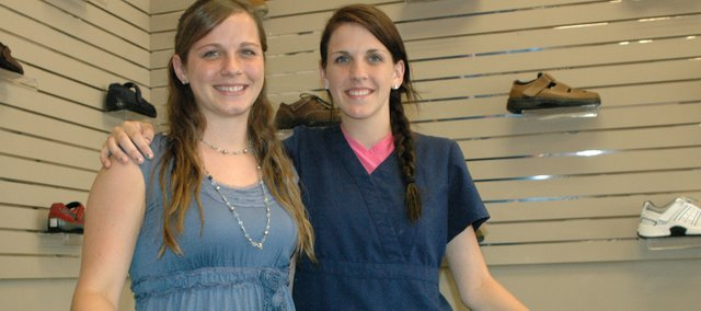 Jennifer Belcher and Kelsey Wagner (from left) are poised to take over their parents' business, Mid Star Lab, creating custom shoe inserts like those shown above. But first they are helping expand the services the business offers.