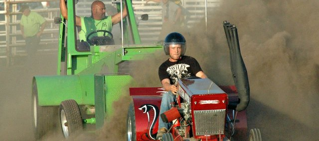 Zack Kirschner kicks up some dirt on Dennis Stottlemire&#39;s tractor &quot;Hyper Viper.&quot;