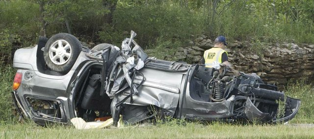Kansas Highway Patrol troopers work the scene of a July 2011 fatality accident on U.S. Highway 24/40 in Leavenworth County.
