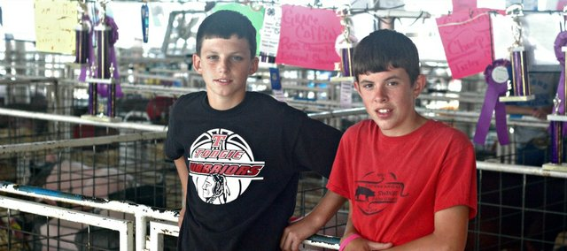 Friends Lane Hecht and Sam Coffin swapped animals to get a different perspective on preparing for the Leavenworth County Fair.