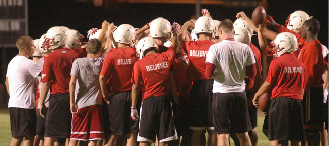 The Tonganoxie High football team kicked off its 2012 season with a 12:01 a.m. practice Monday at Beatty Field.