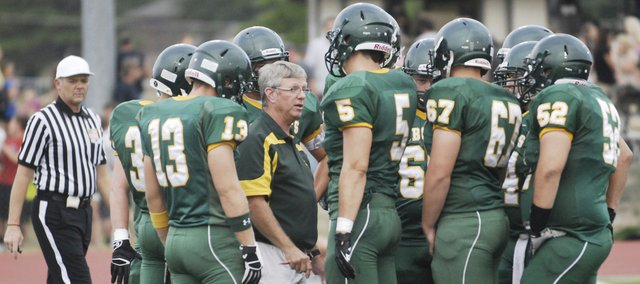 Coach Steve Hopkins and the Bobcats gather during the Aug. 23 Meet the Bobcats scrimmage.