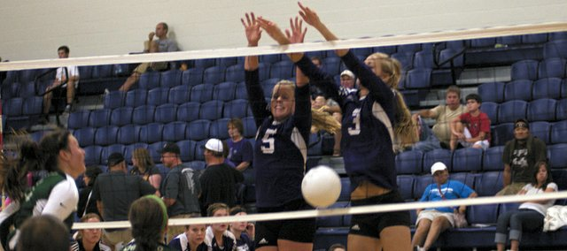 Baldwin High School&#39;s Katie Pattrick, 5, and Morgan Lober, 3, block De Soto at the net during the final set of Saturday third-place match in the Frontier League Invitational. The Bulldogs won the match to earn third place after started the day as the eighth-seeded team.