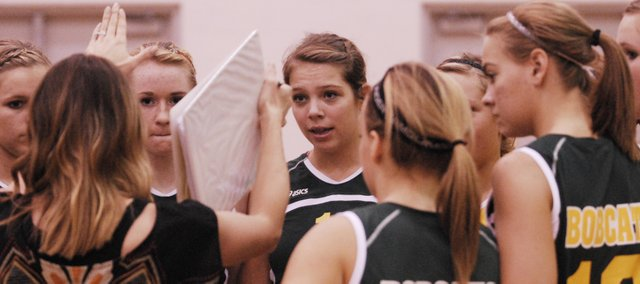 Basehor-Linwood senior Brandi Stahl listens to volleyball coach Amy Irvin during a timeout on Tuesday at a quad meet in Bonner Springs. The Bobcats defeated Bonner Springs and Baldwin, and lost to Eudora.