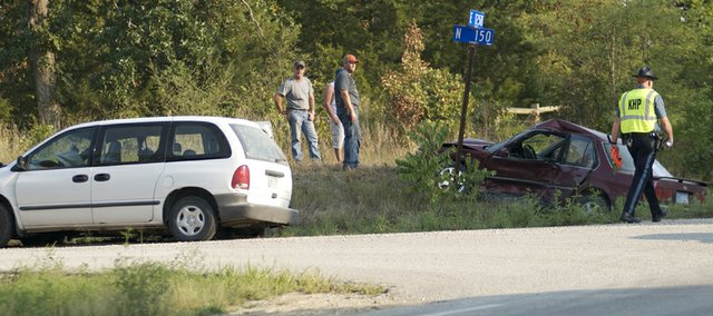 A Kansas Highway Patrol officer works the scene of a fatality accident Tuesday on U.S. Highway 59 in southern Douglas County. The wreck was at the corner of U.S. 59 and Douglas County North 150 Road, two miles south of Baldwin Junction.
