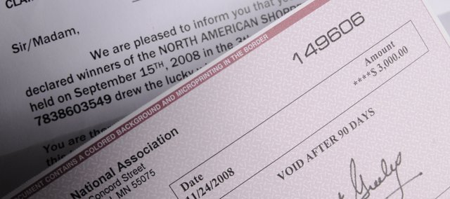 """This file photo shows what appears to be a $3,000 check, sent to a Lawrence woman along with a letter informing her she was a sweepstakes winner. But the check was bad, and the """"sweepstakes"""" was a scam."""
