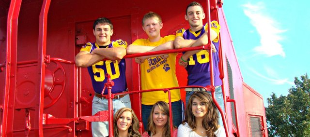 McLouth High School's 2012 homecoming king candidates are, from left, Wyatt Farris, Austin Neuburger and Marc Walbridge. Queen candidates are, from left, Alex Adams, Megan McHenry and Marrisa Raya.