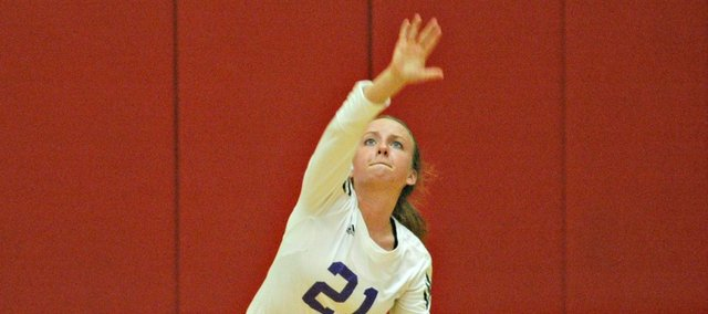 Madeline McCrary puts up a serve in Baldwin High's match Thursday at Tonganoxie. The Bulldogs lost in five sets.