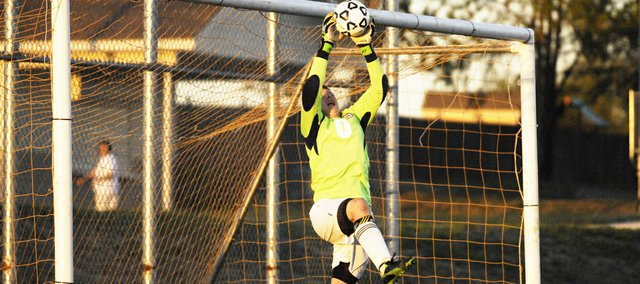 Basehor-Linwood senior goalie Cameron Kennedy makes a leaping save during the Bobcats' 9-0 victory against Immaculata on Monday.
