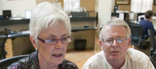 Kansas Insurance Commissioner Sandy Praeger, left, participates in an online chat regarding the Affordable Care Act in the Lawrence Journal-World News Center while public information officer Bob Hanson looks on. Praeger recently issued answers to frequently asked questions about the health reform law.