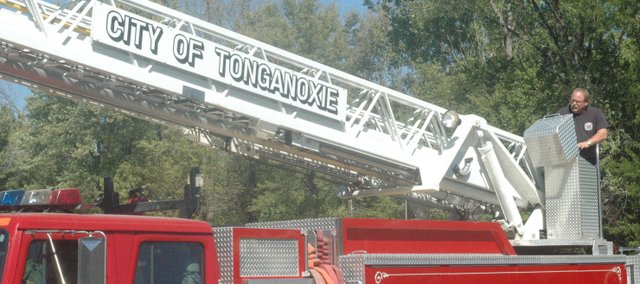 Tonganoxie Deputy Fire Chief John Callaghan conducts weekly maintenance on one of the department's trucks Monday near the Tonganoxie City Fire Station. Area cities can find themselves competing with other local communities because of higher pay for its employees in fire, police, public works and other departments.