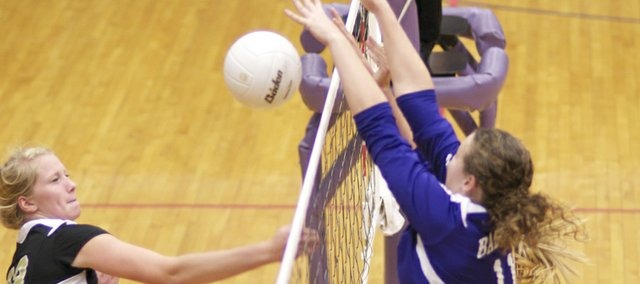 Baldwin's Alexia Stein gets a block in the volleyball team's match Tuesday against Paola. The Bulldogs lost the match in three sets.