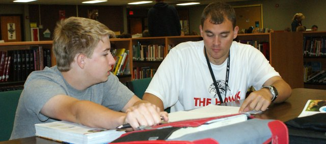YouthFriend mentor Donnie Dempewolf (right) helps Basehor-Linwood High School sophomore Clark Briscoe with a homework time during an advisory period.