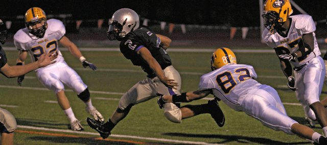 Baldwin junior Cornell Brown busts a tackle in the Bulldogs' 14-12 loss Friday to Spring Hilll.