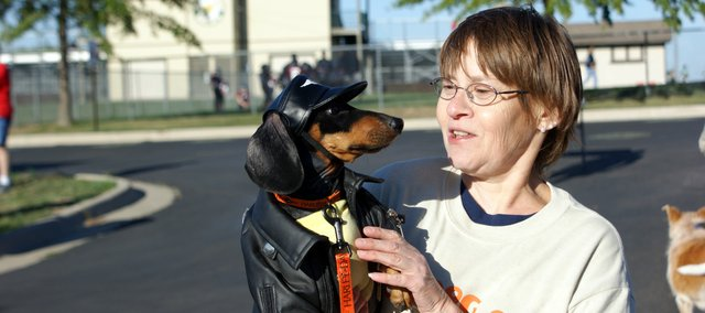Penny Kolojaco holds her dog Jackson after completing the Go Dog Go walk to raise money for the Leavenworth County Humane Society. About 45 people participated in the event at Basehor on Saturday morning.
