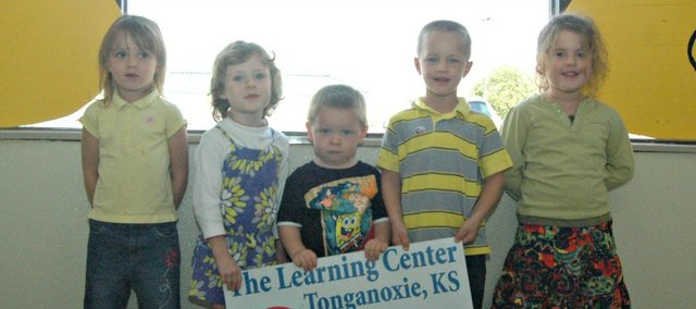 The Learning Center in Tonganoxie has an enrollment of just more than 30 students, including, from left, Kaylee Mathia, 4, Hannah Clinger, 3, Brayton Scacchi, 2, Wyatt Mustard, 4, and Farrah Halsa, 4.