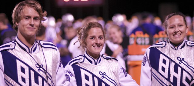 Baldwin High School drum majors Max Combest, Abby Clem and Katelyn Johnson are helping prepare the school's marching band for a busy October.