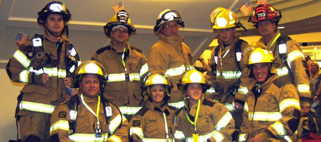 Fairmount Township firefighters who participated in the 9-11 memorial stair climb were (front row, from left) Jarrod Basgall, Stephanie Leonard, Haley Hanna, Brandon Roberts; (back row) Steve Marquardt,  Ricky Bevell, Tony Turner, Josh Stillian and Olie Olesen.
