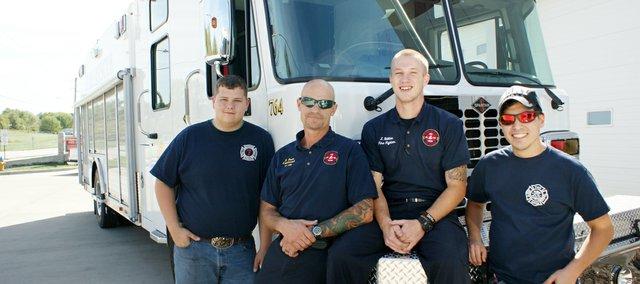 Cadet Dilynn Scheets, Lieutenant Olie Olesen, Josh Stillian and Cody Ferguson (from left) pose by the Fairmount Township Fire Department's new rescue truck.