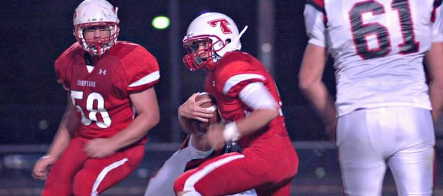 Tyler Ford accounted for three touchdowns in Tonganoxie's 30-16 win Friday against Bishop Ward.