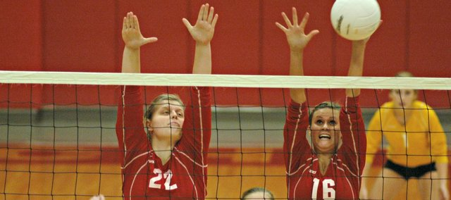 Katelyn Waldeier, left, and Cheyenne Ford helped Tonganoxie High defeat Piper in straight sets on Tuesday.