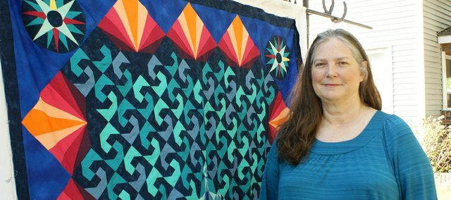 Judy Masur had to use the Storm at Sea design to create the quilt behind her. It was her first of three challenges for the McCall's Quilt Design Star competition. From a field of 30 admitted to the contest, only she and eight others are still competing.