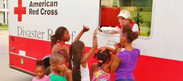 Terry Mille of Bonner Springs took this photo of children lining up at the emergency response vehicle for a hot, nutritious meal in the Upper 9th Ward in New Orleans following Hurricane Isaac. Mille was deployed to the area for two weeks in early September as a Red Cross volunteer to aid residents who lost power following the hurricane.