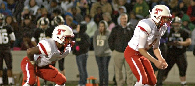 Cole Holloway, left, had 118 rushing yards and a touchdown, but the Chieftains couldn't get by Turner on Friday.