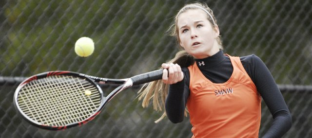 SMNW's Colleen Freeman advanced to state as part of the Cougar's No. 1 doubles team that finished fifth at Saturday's 6A regional tournament at Harmon Park in Prairie Village. Both the No. 1 and No. 2 SMNW doubles teams will return to the park for next weekend's state tournament.