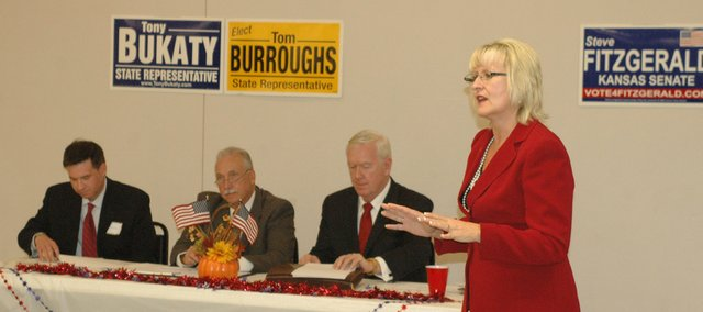 Sen. Kelly Kultala addresses the crowd Thursday, Oct. 4, at the Bonner Springs-Edwardsville Chamber of Commerce's candidate forum, as Tony Bukaty, Rep. Tom Burroughs and Steve Fitzgerald (seated from left) await their turn.